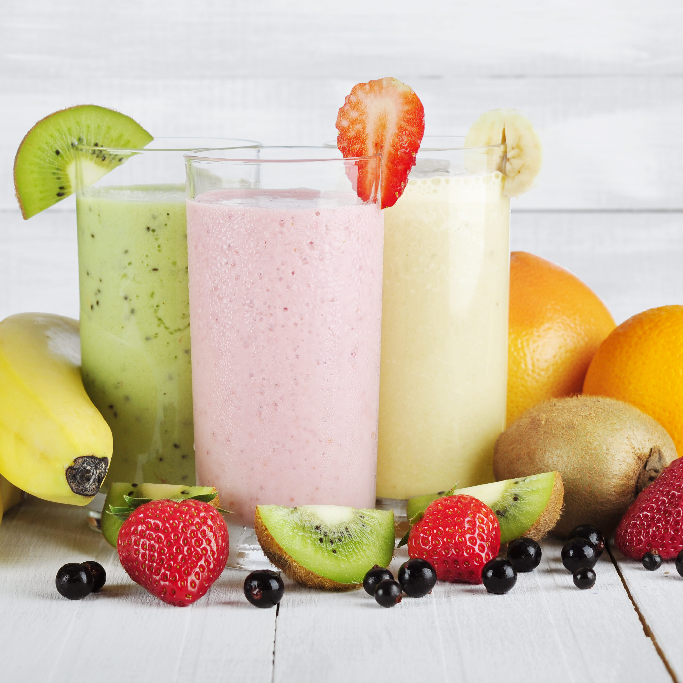 Fruit,Smoothies,With,Black,Currant,,Strawberry,,Kiwi,,Orange,And,Banana